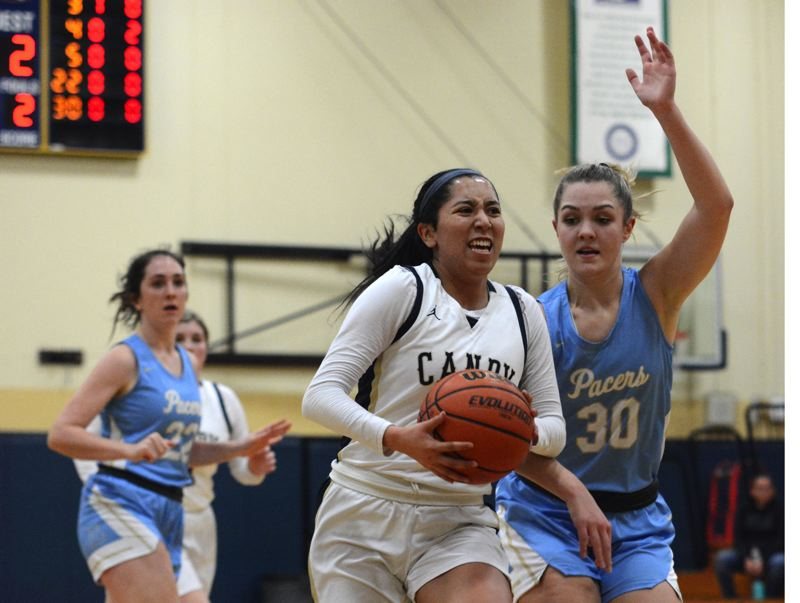 PMG PHOTO: DEREK WILEY - Canby senior point guard NaaraiGomez drives to the basket Tuesday against Lakeridge.