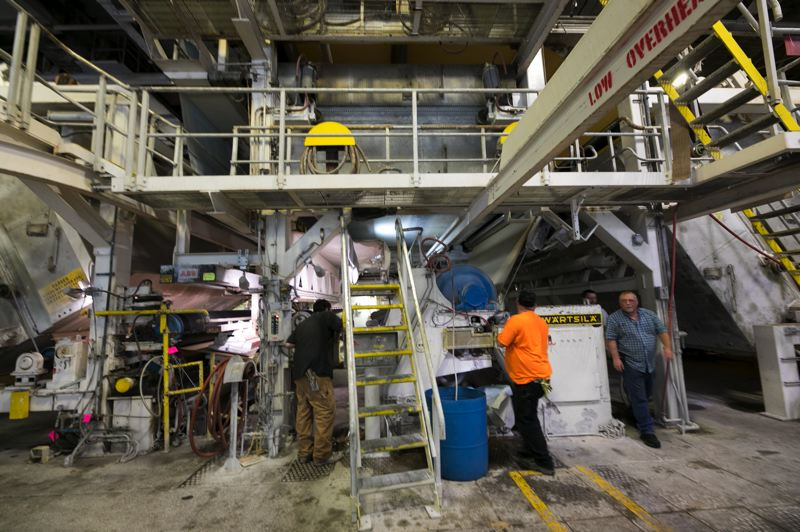 PAMPLIN MEDIA GROUP: JAIME VALDEZ - Workers on Machine Number 3 at the Willamette Falls Paper Company in West Linn where they are making brown craft paper with 40 percent straw content.