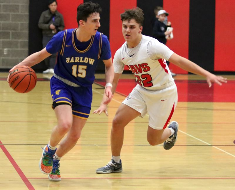PMG PHOTO: JIM BESEDA - Barlows Jesse White drives past Clackamas defender Jackson Jaha during the Bruins 82-76 overtime win Tuesday.
