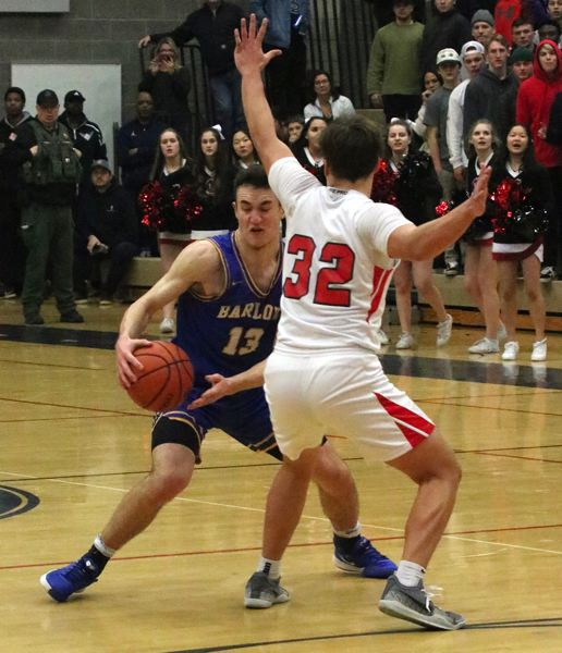 PMG PHOTO: JIM BESEDA - Barlows Evan Inglesby sidesteps Clackamas defender Jackson Jaha. He would hit a buzzer-beating 3-pointer to send the game into overtime.