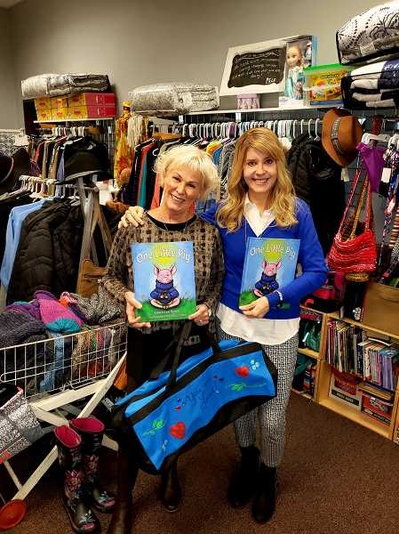 COURTESY PHOTO  - Patti Serres, left, founder of Bloomin Boutique, and West Linn author Laura Lee Scott pose with items they are supplying children in the foster care system. Bloomin Boutique affords children a shopping experience for items they need and want. Scott recently donated 115 of her book 'One Little Pig' to Bloomin Boutique, and has started a GoFundMe campaign to raise funds so she can continue to donate books to the nonprofit.
