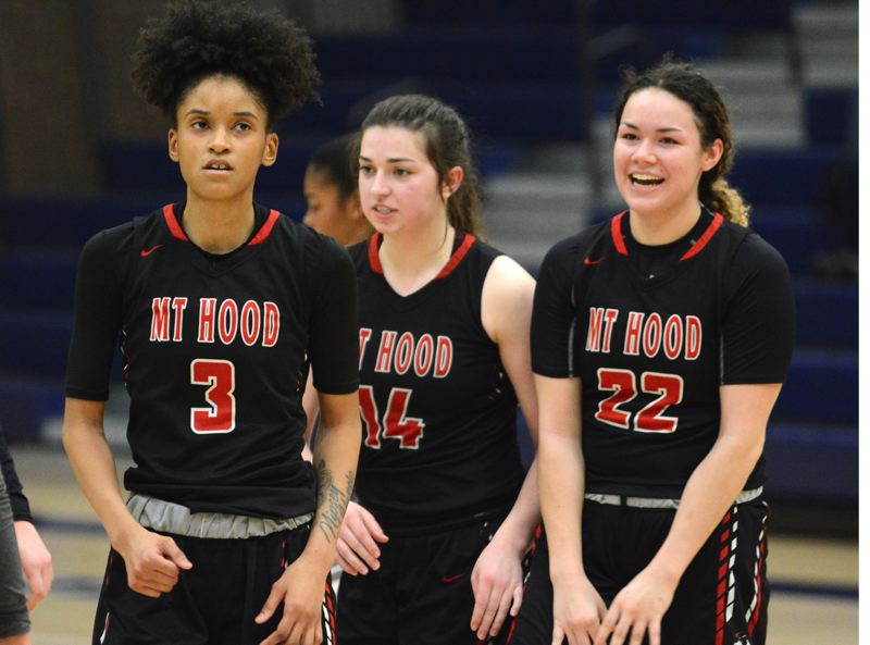 PMG PHOTO: DAVID BALL - Mt. Hoods Tatyana Lyles (3) looks to the scoreboard after hitting the winning shot with 2.8 seconds left Wednesday at Clackamas.