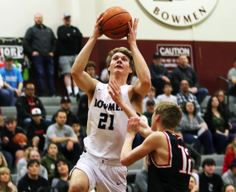 PMG PHOTO: DAN BROOD - Sherwood High School senior post Blake Jensen looks to go up to the basket during the Bowmen's 112-27 Pacific Conference win over McMinnville.