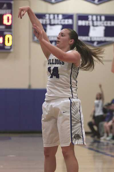 PMG PHOTO: PHIL HAWKINS - Woodburn senior Willow Neshem was 3-of-9 from 3-point range, finishing with nine points in the Bulldogs' 49-31 win over Sisters.