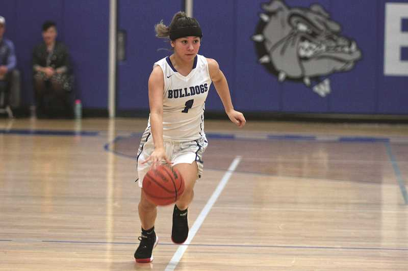 PMG PHOTO: PHIL HAWKINS - Woodburn sophomore Mya Salinas was one of five Bulldog players to connect from long range in the team's 49-31 win over Sisters.