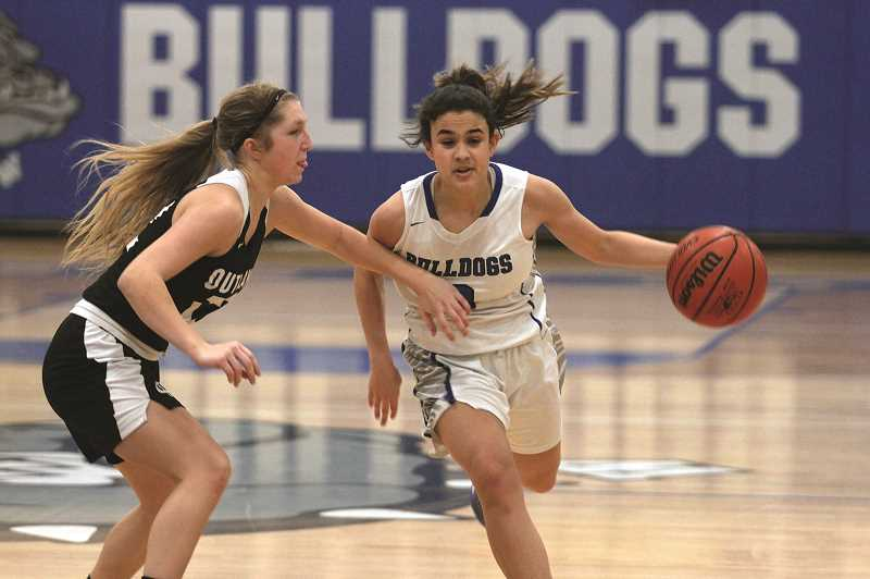 PMG PHOTO: PHIL HAWKINS - Sophomore guard Aria Kent stuffed the stat sheet for the Bulldogs, finishing with 11 points, seven assists, six rebounds and five steals in the win.