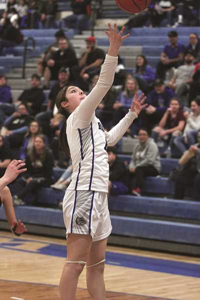 PMG PHOTO: PHIL HAWKINS - Junior guard Eliana Arechiga was one of nine Woodburn players to log at least one field goal and one rebound in the win over Sisters.