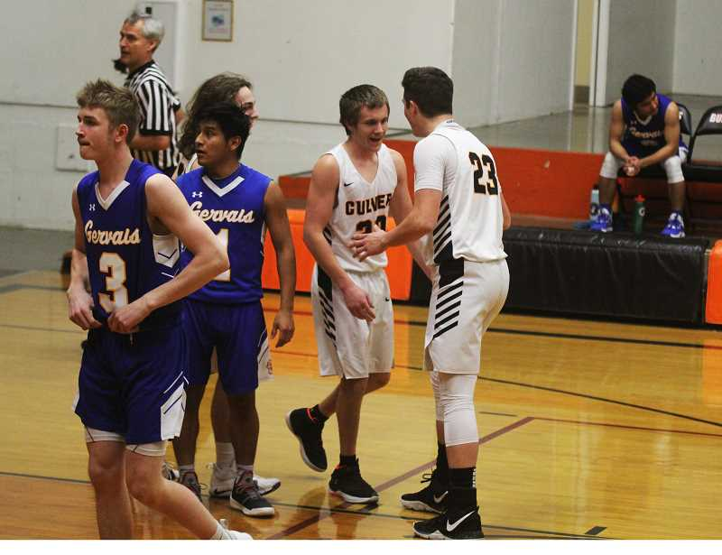 STEELE HAUGEN - Cord Gomes (23) high fives Austin Williams after Williams made an and-1 basket to start the game.