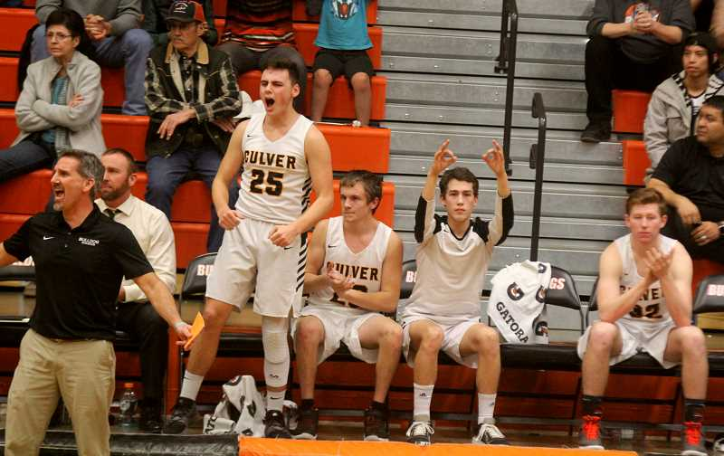 STEELE HAUGEN - The Culver bench celebrates during the game.