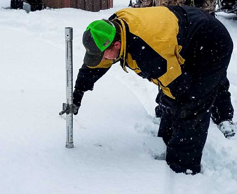 PHOTO SUBMITTED BY OCHOCO IRRIGATION DISTRICT  - Ochoco Irrigation District staff members check the snowpack at three different locations on a monthly basis during the winter.