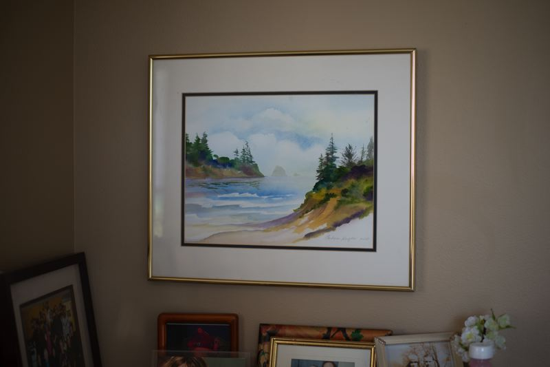 PMG PHOTO: ANNA DEL SAVIO - Watercolor paintings hang throughout the Hughes' apartment, including a coastal scene Barb painted in 2013.