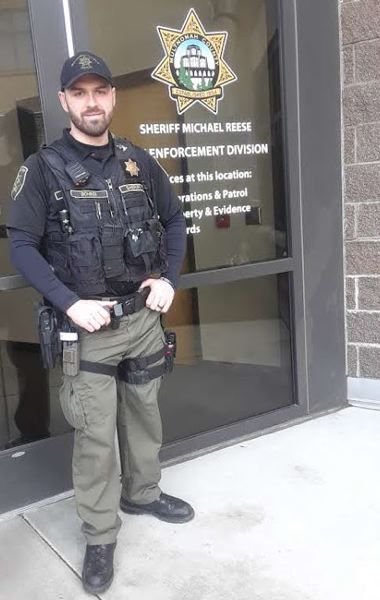 PMG PHOTO: SHANNON O. WELLS - Multnomah County Sheriffs Deputy Nick Bohrer stands in front of the Troutdale Sheriffs Operations Center on Wednesday, Feb. 12, after being introduced to local media outlets as the citys first community resource officer.