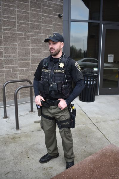 PMG PHOTO: SHANNON O. WELLS - MCSO Deputy Nick Bohrer, Troutdales new community resource officer, will spend his time addressing ongoing community problems such as illegal drug houses, transient-related issues, school-zone speeding and enforcing code-compliance regulations on residences.