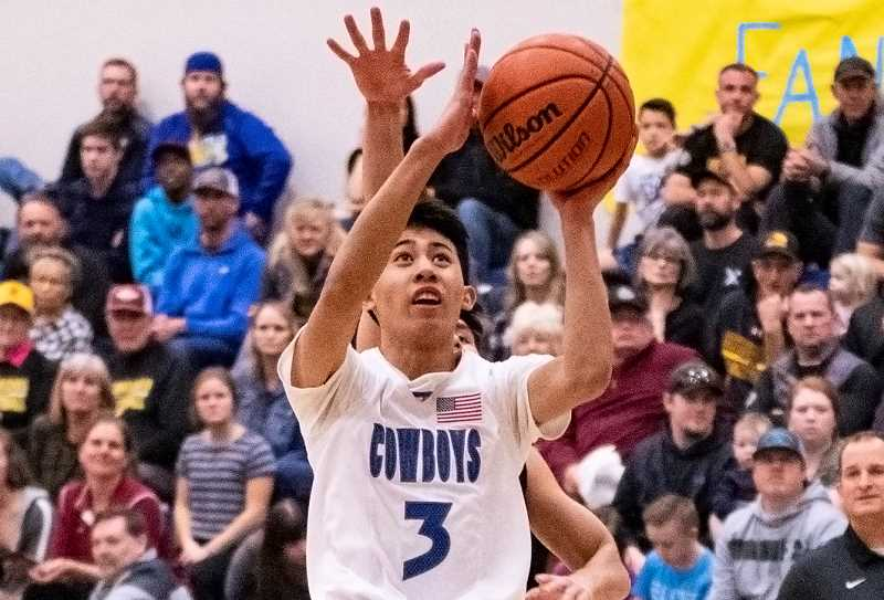 LON AUSTIN/CENTRAL OREGONIAN - Jrei Ramirez goes up for a shot earlier this year. Ramirez scored 15 points on Tuesday as the Cowboys lost 62-48 to the Pendleton Buckaroos. The loss dropped Crook County to a tie for second place in the Intermountain Conference, while Pendleton is now alone in first place.