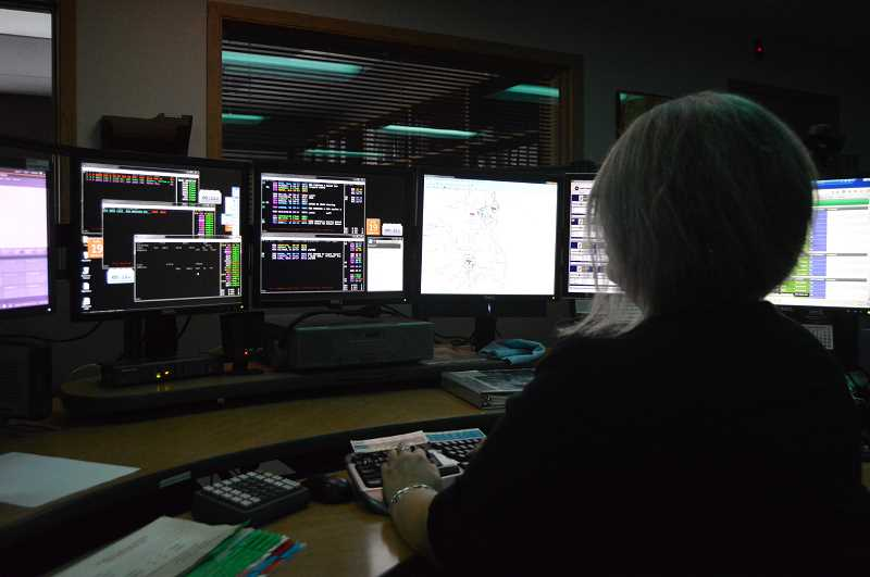 PMG FILE PHOTO - A worker at the Columbia 911 Communications headquarters in St. Helens. Columbia 911 has been the target of numerous harassment claims and lawsuits over the past few years.