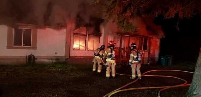 SCAPPOOSE FIRE DISTRICT - Firefighters respond to a house fire on Chapman Road on Thursday, Feb. 13.