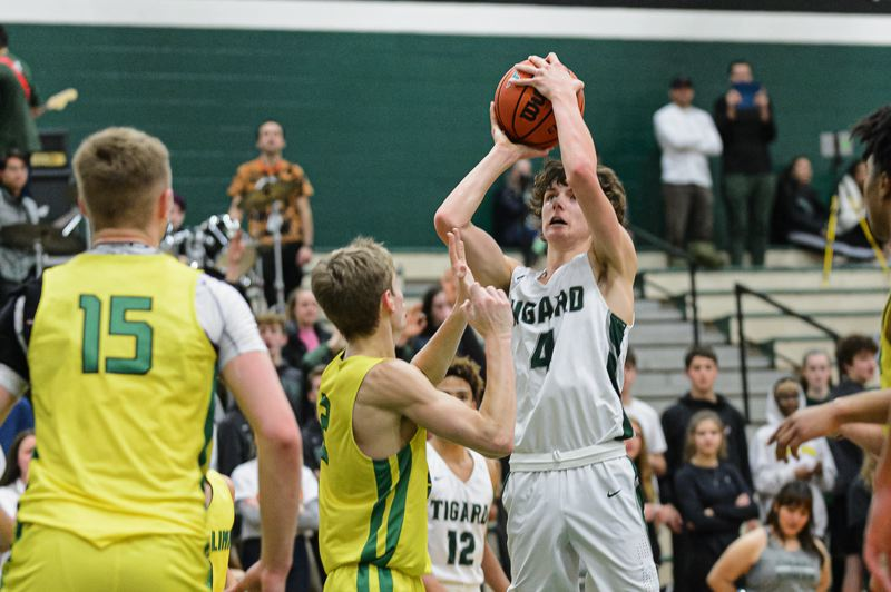 COURTESY PHOTO: CHRIS GERMANO - Tigard High School junior Brett Moss (4) goes up for a shot during the Tigers' 84-74 win over West Linn on Tuesday. The Tigers have a bye from Three Rivers League play tonight, while the Lions will look to bounce back in a 5:45 p.m. game at Tualatin.