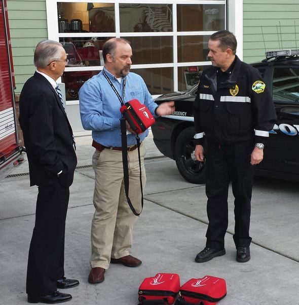 PMG FILE PHOTO - At a promotional event in 2014, West Linn Police Chief Terry Timeus, from right, with Capt. Dave Halley of Tualatin Valley Fire & Rescue, and then-West Linn Mayor John Kovash.