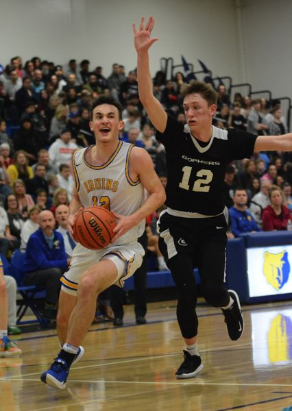 PMG PHOTO: DAVID BALL - Barlows Evan Inglesby moves to the basket a step ahead of Greshams Ethan Abrahamson during the Bruins 60-42 home win Friday.