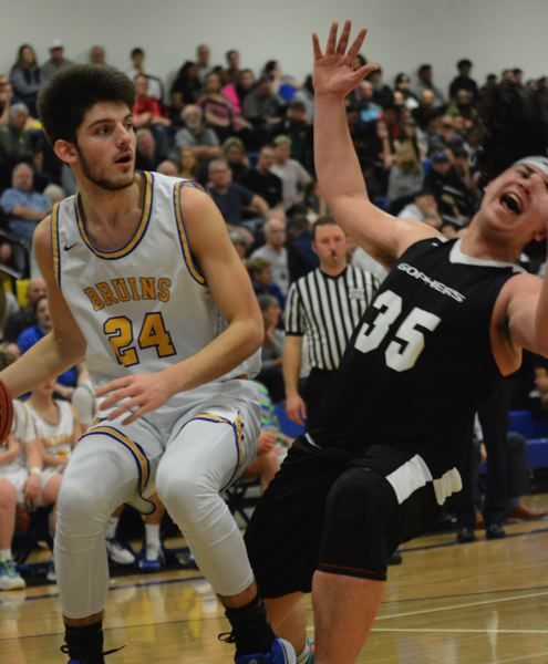 PMG PHOTO: DAVID BALL - Barlows Joey Wolcott drives to the block, while Greshams Syrus Sagiao attempts to draw a charging foul.