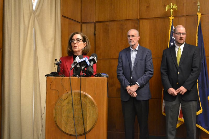 OREGON CAPITAL BUREAU: CLAIRE WITHYCOMBE - Gov. Kate Brown, Greg Miller, representative of the timber coalition, and Bob Van Dyke of the Wild Salmon Center, announce the deal between logging and environmental interests Monday, Feb. 10.