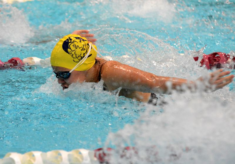 PMG PHOTO: DEREK WILEY - Canby freshman Avery Keinonen swims butterfly Saturday at Mt. Hood Community College.