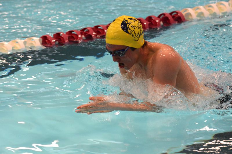 PMG PHOTO: DEREK WILEY - Canby senior Jordan Spencer swims breaststroke Saturday morning at Mt. Hood Community College.