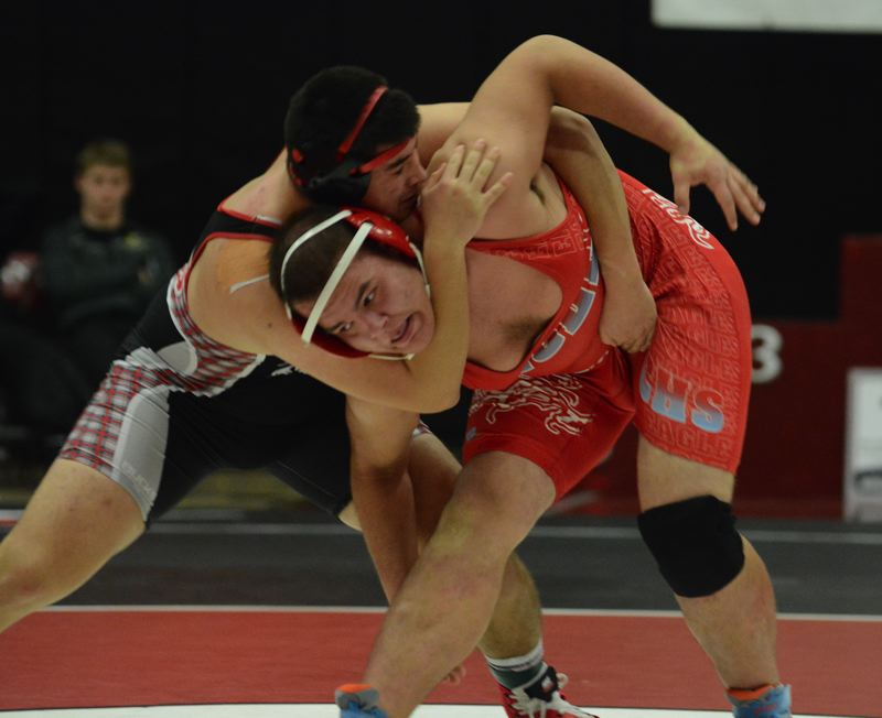 PMG PHOTO: DAVID BALL - Centennials Emanuel Gurzhuy works loose from David Douglas Johnny Martinez on his way to winning the 220-pound finale by a pin in the third round.