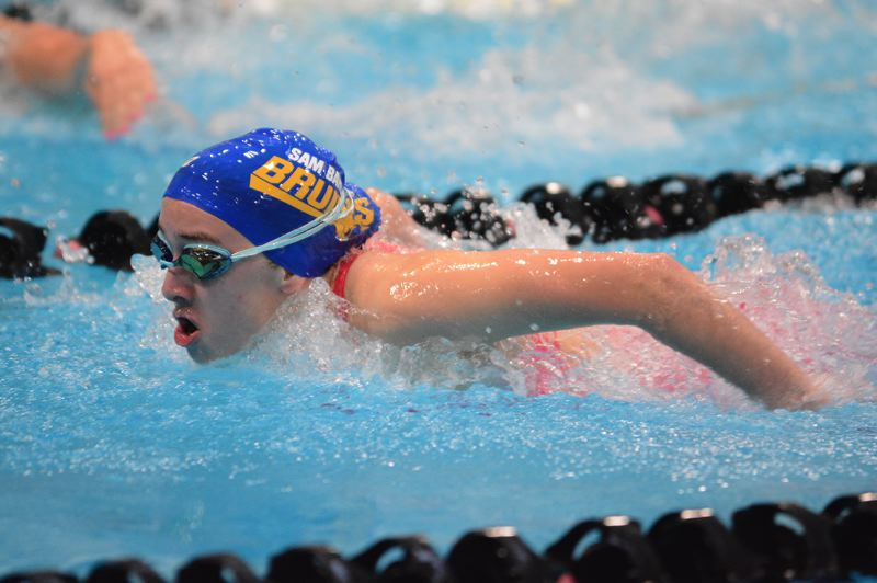 PMG PHOTO: DAVID BALL - Barlow's Megan Maroon crashes through the waves on her way to a win in the butterfly.
