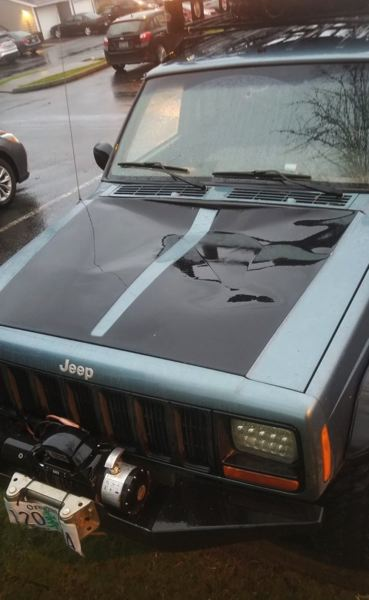 XJ's hood damaged by the snow