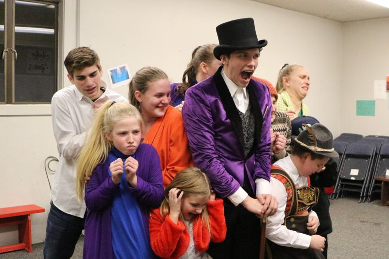 COURTESY PHOTO: EASTSIDE THEATER CO.  - Anchored by Simeon Johnson, center, as the title character, part of the Eastside Theater Companys cast of Willy Wonka rehearses for the upcoming run of shows for the classic tale of an eccentric chocolate factory owner and the children who get to tour it.