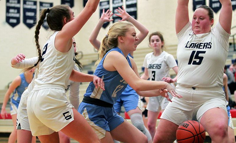 PMG PHOTO: MILES VANCE - Lakeridge's Emma Krauss challenges the Lake Oswego defense during her team's 64-18 win at Lake Oswego High School on Friday, Feb. 14.