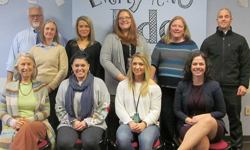 PMG PHOTO: ELLEN SPITALERI - Members of the Clackamas County Human Trafficking Multidisciplinary Team include, front row, left to right: Pam Rivers, Jana Wiseman, Allie Martin and Torrey McConnell. Back row, Bill Stewart, Erin Prendergast, Kelly Walsh, Keysha Kendall, Carrie Walker and Rusty Amos.