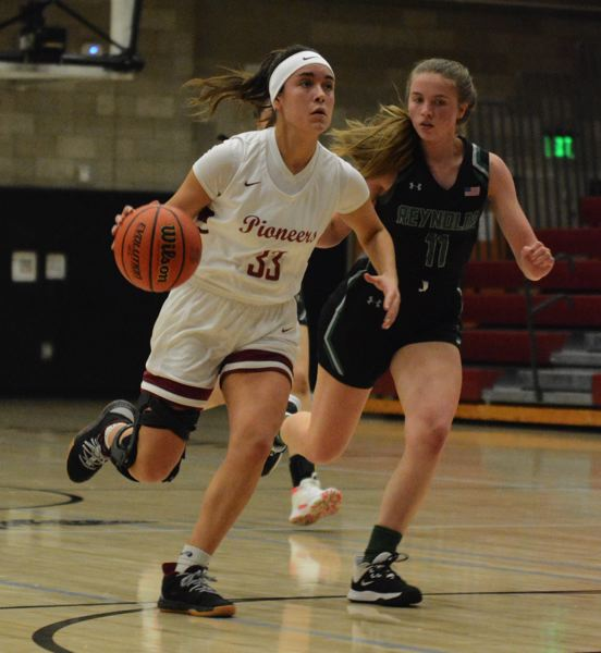 PMG PHOTO: DAVID BALL - Sandys Rachel Remsburg drives into the lane. The Pioneers picked up wins over Gresham and Reynolds and finished the week fifth in the Mount Hood Conference with a 5-6 league record.
