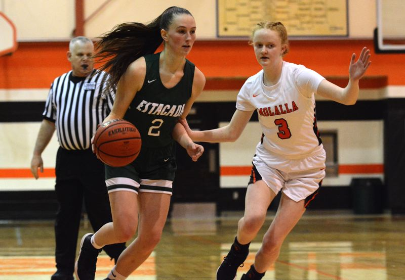 PMG PHOTO: DEREK WILEY - Estacadas Makaelyn Jennings drives into the lane during Fridays 61-39 loss at Molalla.