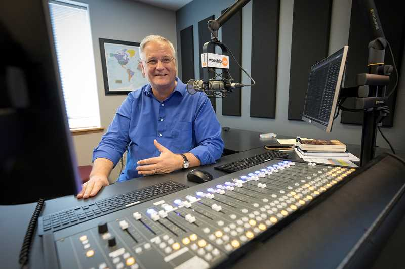 PMG PHOTO: JAIME VALDEZ - David Harms sits behind the console where he broadcasts his Worship 24/7 internet and radio station in Wilsonville.