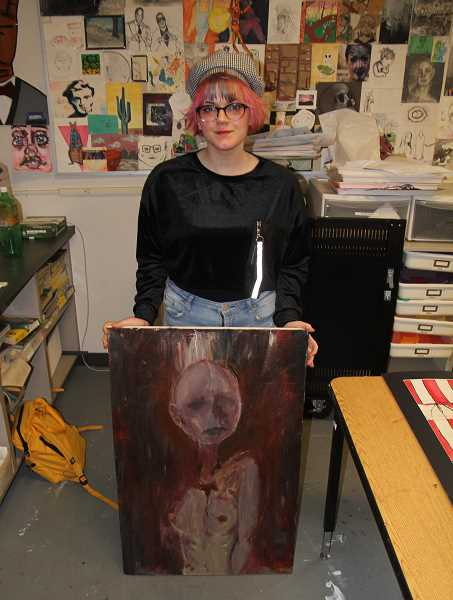 PMG PHOTO: JUSTIN MUCH - Woodburn High School sophomore Ollie Knolson shows her untitled painting, which was a Gold Key recipient among the 2020 Oregon Scholastic Art Awards.