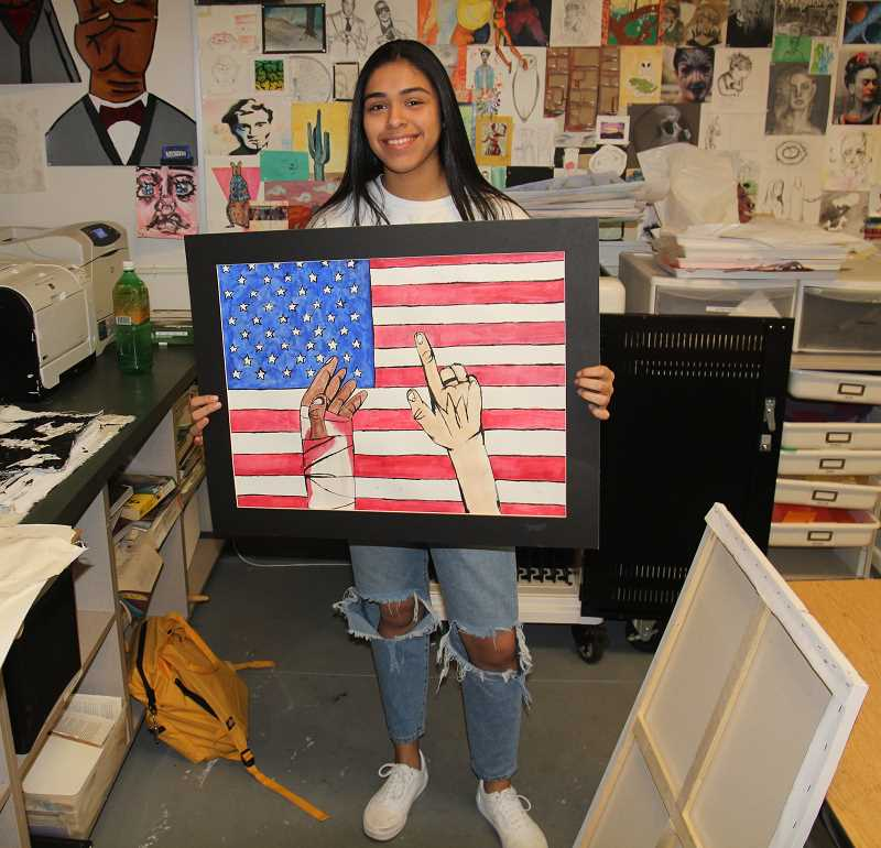 PMG PHOTO: JUSTIN MUCH - Woodburn High School junior Zoey Benevidez displays her drawing & illustration, Justice & Liberty for ALL, which recieved a Gold Key from the 2020 Oregon Scholastic Art Awards.