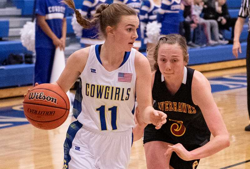 LON AUSTIN/CENTRAL OREGONIAN - Dallas Hutchins drives to the basket during the Cowgirls' meeting earlier this year with The Dalles Riverhawks. Hutchins scored 20 points on Thursday as the Cowgirls lost 52-32 to the Riverhawks in a road contest.