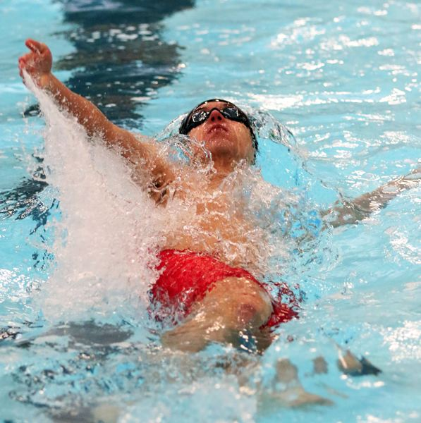 PMG PHOTO: DAN BROOD - Nathaniel Whitehead, a junior on the Tigard High School boys swim team, is on his way to a second-place finish in the 100-yard backstroke event at the Three Rivers League district meet on Saturday.