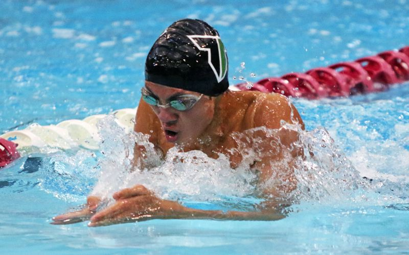 PMG PHOTO: DAN BROOD - Tigard High School junior Jaden Nguyen took second place in the 100-yard breaststroke event at the Three Rivers League district championships on Saturday.