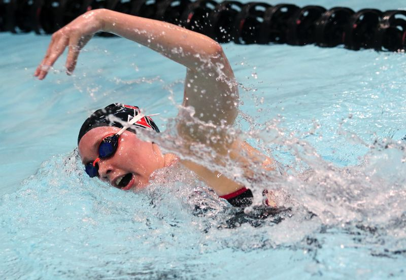 PMG PHOTO: DAN BROOD - Tualatin High School senior Abbi Karsseboom is on her way to victory in the 500-yard freestyle event during Saturday's finals at the Three Rivers League district swim meet.