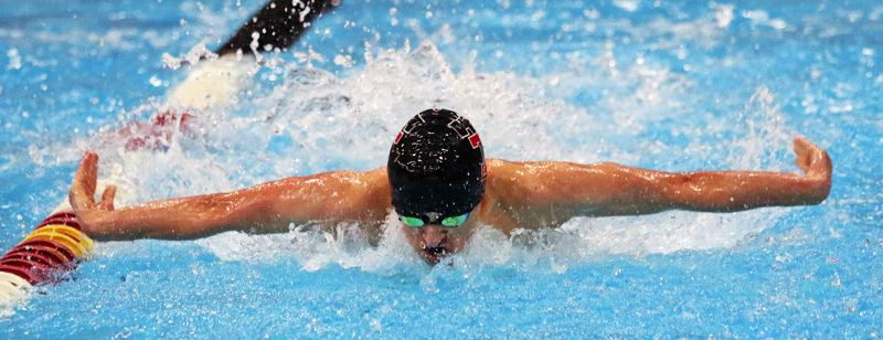 PMG PHOTO: DAN BROOD - Tualatin High School freshman Ben Glasser finished second in the 100-yard butterfly event at the Three Rivers League district meet to earn a trip to state.