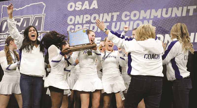 PMG PHOTO: JONATHAN HOUSE - NHS cheerleaders and their coaches celebrate their first-place trophy in the Class 6A competition Saturday in Portland.