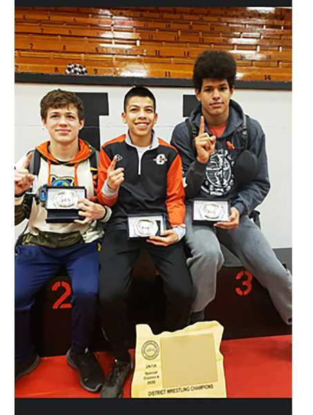 SUBMITTED PHOTO - Left to right, senior Lane Downing (145), freshman Debren Sanabria (106) and sophomore Isaiah Toomey (160) placed first at the district tournament in Union Feb. 15.