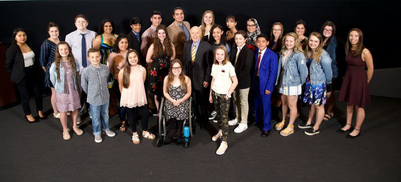 PMG FILE PHOTO - The 2019 Amazing Kids selected by Pamplin Media Group newspapers pose for a photo at OMSI with Robert B. Pamplin Jr., owner of the Pamplin Media Group.