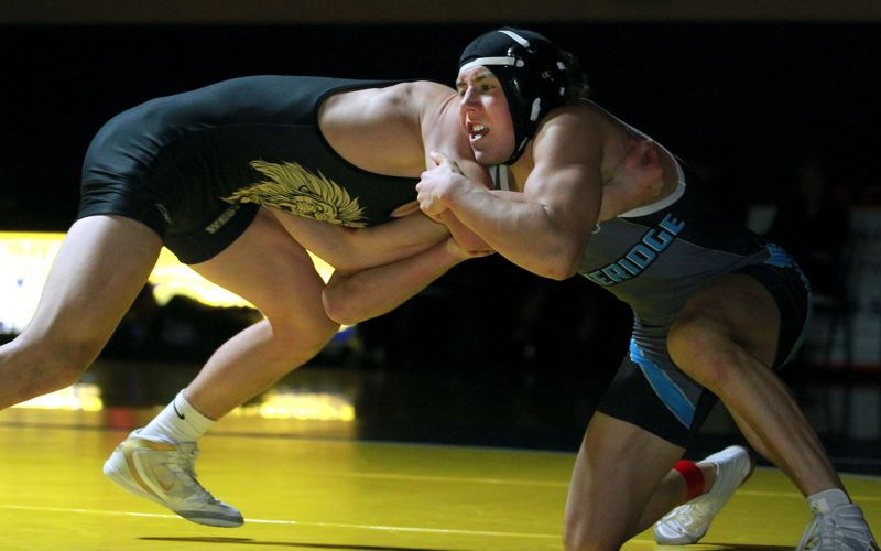 PMG PHOTO: MILES VANCE - Lakeridge junior Ryan Boucher (right) works against West Linn's Justin Rademacher during the 160-pound championship match in the Three Rivers League district tournament at Canby High School on Saturday, Feb. 15.