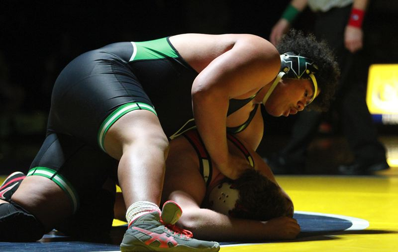 PMG PHOTO: MILES VANCE - Tigard High School senior Johnny Nomani is in control in his 285-pound championship match against Oregon City's Zachary Zumwalt at the Three Rivers League district tournament.
