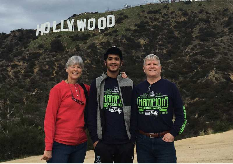 COURTESY PHOTO: MARILYN BEYER -  Sultan at the Hollywood sign on a trip in California with host parents, Marilyn (left) and Gary (right) Beyer