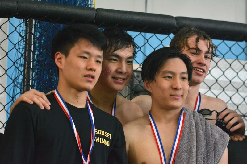 TIMES PHOTO: MATT SINGLEDECKER - The Sunset boys 200-yard freestyle relay won the Metro League championship last weekend.